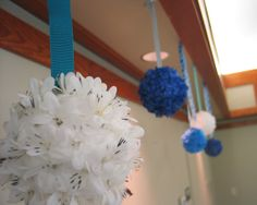 I love these feather fluff balls for a bird-themed wedding!  They hang nicely from the eaves of the pavilion.