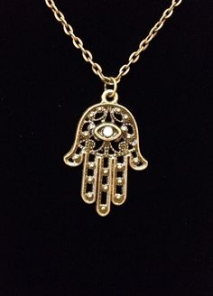 A personal favorite from my Etsy shop https://www.etsy.com/listing/247276125/bronze-and-pearl-hamsa-hand-of-fatima