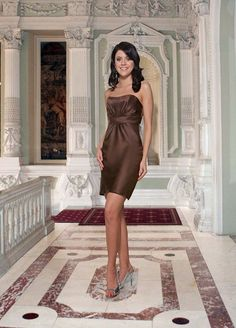 Satin spans the sheath silhouette of Da Vinci 9276 Bridesmaid Dress, arrayed with a slightly scooped strapless neckline.