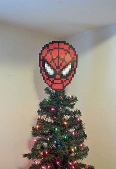 Hey, I found this really awesome Etsy listing at http://www.etsy.com/es/listing/166533903/spiderman-perler-bead-christmas-tree
