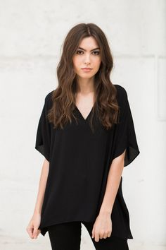 """An easy, draped top that is both versatile and flattering with its split neckline and batwing sleeves. Length: 25.5"""" from shoulder Measurements taken from size"""