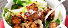 Add some oomph to tofu with a sticky ginger marinade. This simple recipe is quick to make and perfect served with pak choi on a bed of jasmine rice