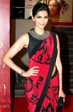 Sonam Kapoor goes for the embellished neckline teamed with a pattern pink and black sari...nice!