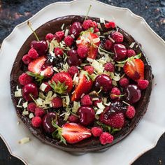 Festive Fare: Dark chocolate, cherry and coconut cheesecake recipe, Bite – This is a stunner of a dessert and the base is gluten-free, made with coconut, almond meal and Medjool dates Coconut Cheesecake, Cheesecake Recipes, Dessert Recipes, Dessert Ideas, Cake Ideas, Coconut Jam, Chocolate Cherry, White Chocolate, Cocoa Cinnamon