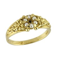 Pearls and a black diamond in a antique-style setting would make a lovely ring for a bride to be.