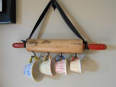So love this DIY fun!! Rolling pin hold measuring cups!