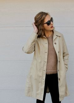 Trench coat, brown sweater, black jeans and leather Chelsea booties + beach waves
