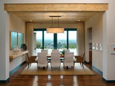 The HGTV Dream Home 2010 dining room table and chairs parallel the wood ceiling and outline the clean, sparse lines of this contemporary space.