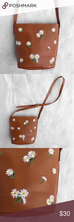"brown floral embroidered crossbody bucket bag •dimensions: 8.5"" x 9"". dimensions of bottom: 7"" x 5""  •features: has a zipper and a pocket inside and in the back   •no trades Daisys Boutique Bags Crossbody Bags"