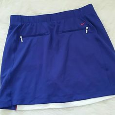 ??Nike dri fit golf skort?? NWOT. Purchased and removed tags and realized golf and I don't mix! Can't return now. DRI fit. Royal blue and bright white. Nike Skirts