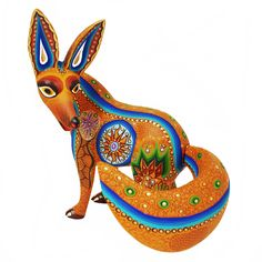 Luis and Margarita Sosa created this elegant cinnamon colored fox wood carving. Their painting is as always beautiful!