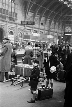 George Rodger G.B. ENGLAND. London. Westminster. Paddington Station. School boys with gas masks evacuated by train as bombing raids intensify. Life in London during The Blitz of World War II in 1939-40....