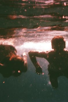 I love under water pictures and this one is great because of the sun that seems to be setting.