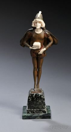 After Professor Otto Poertzel (German, 1876-1963)       Cold-painted Bronze of a Page Boy with a Casket
