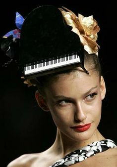 This grand piano hat is just a little over the top, but wow! Only on the runway... #music #fashion