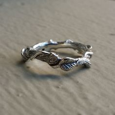 Check out this item in my Etsy shop https://www.etsy.com/listing/250969751/14k-gold-leaf-twig-and-vine-ring-hand