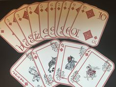 This is a set of 14 Alice in Wonderland Playing Cards. Included is one of each - Ace, Two, Three, Four, Five, Six, Seven, Eight, Nine, Ten, Jack, Queen, King and Joker. This set is the red diamonds. All cards are 4 inches wide by 5 inches in height. They are printed on white card stock (110lb weight).  These cards are perfect for décor. They can be used as a table number, place card, gift tag, or other decoration. You could string them together to make a fun banner to hang or embellish a…
