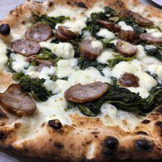 Pizza with sausages, friarielli (neapolitan herb with a bitter finish) and provola cheese. I wanna dive into!