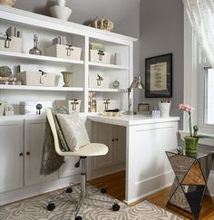 Great use of space for an office. Built in book shelves with built in desk.