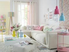 Whites, yellows, pinks. Bookshelf & light fixtures. Fun pillows, bold wallpaper. White picture frames. Lamp. Oh, everything! <3
