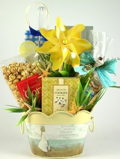 Island Breeze Tropical Gift Basket    This cheerfully crafted beauty features a host of gourmet gifts, in a wonderful metal pail that boasts a heartwarming message; perfect for portraying your sentimental side.  What a special gift for that perfect friend! $58.99   http://www.littlegiftbasketboutique.com/item_709/Island-Breeze-Tropical-Gift-Basket.htm