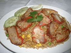 BBQ Pork Fried Rice: Fried rice with barbeque pork, egg, onion, tomatoes, peas, and carrots. #rice #vegetables #Awesome Thai #Food forked.com