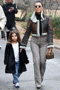 Kourtney Kardashian wearing Louis Vuitton Monogram Canvas Mini Hl Speedy Bag, Balenciaga Fall 2003 Palma Leather Aviator Jacket and R13 Kick Flare Trousers in Prince of Wales Check