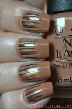 part 1 - mix brown and white together to make it lighter, grey, black, brown, orange/brown, gold glitter lines using brushes