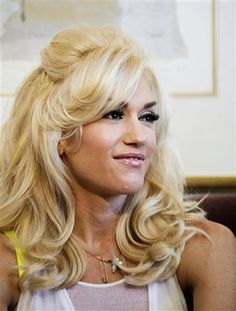 I love the Look of Gwen's Vintage Style Coiffed Locks & make-up. She looks like Nancy Sinatra here- Freakin' FAB !!