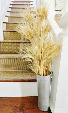 Simple easy fall decorating idea!  Just add wheat to buckets on the stairs!