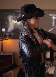 Tom Cruise as Stacee Jaxx (the reason I have to watch Rock of Ages with either the air on or the windows open...lol)