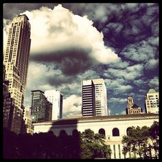 View towards the east from Bryant Park, New York, NY #bryantpark #library #nyc #midtown #park #parksinthecity #clouds #cloudy #cloudysky #sky #storm #skyline #cityscape - @arnab11- #webstagram