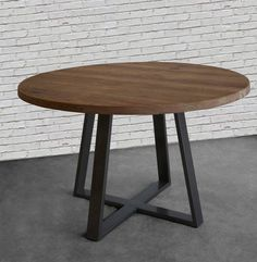 Round dining table in reclaimed wood and steel by UrbanWoodGoods
