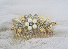 This vintage inspired organic bridal styling hair comb features gold color palette, ivory pearls and silver crystal details...  The style of this gorgeous wedding headpiece is that can be worn from day to night, and occasions beyond the wedding day. Something a little different and unexpected  Measurement* 2 x 3.5 at the widest point  ................................  SukranJewelry designs are premium quality costume jewelry All my pieces are handcrafted in my home studio in Tampa, FL…