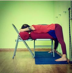 "Sheela on Instagram: ""Ardha Prasarita Padottanasana, restorative-style with chairs + bolsters + blankets. Back of legs & hips against the wall for support and…"""