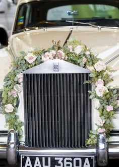 Floral wreath for the getaway car by Antebellum Design. Vintage car from Blue Diamond Limousines. Styled shoot by Jacqueline Events & Design. Photo by Edmonson Weddings. #wedding #transportation #decor #floral #wreath #pink