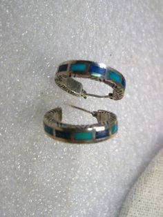 Vintage Jewelry: Vintage Sterling Silver Southwestern/Native American pierced hoop earrings with inlaid turquoise and lapis lazuli on the outer part of the hoop. The hoop is an engraved/stamped design. They are 3/4 wide and the outer with is 4.1mm wide. It is signed 925, LT Thailand on the inside of the hoop. These came from an estate sale in PA. Good condition. See photos. (Locator Lot Win.03.5.16.6)   You can search me on pinterest under pinterest.com/mariasvinta0654 where I have most of…