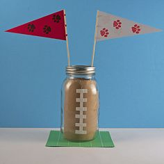 Mason Jar Football Centerpiece Create these simple centerpieces in your team or school colors for your next football banquet or tailgate party.
