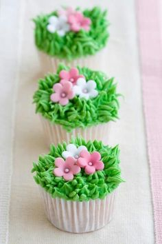 Photo about Mini cupcakes decorated with frosted grass and pink flowers. Image of baking, decorated, cupcakes - 12591477 Cupcakes Design, Cupcakes Cool, Spring Cupcakes, Easter Cupcakes, Flower Cupcakes, Beautiful Cupcakes, Mocha Cupcakes, Banana Cupcakes, Diy Cupcake