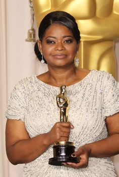 Minnie: hands-down favorite character ever, played by Octavia Spencer in the film