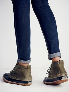 Out N About Weather Boot   Don't let the bad weather cramp your style, these good-looking weather boots are cute and waterproof.  Handcrafted with an adjustable bungee lace-up and durable textured soles made from natural rubber.   *By Sorel