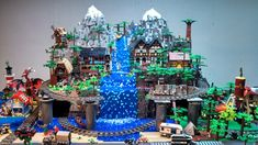 Lego Mountain Village is medieval themed. The surrounding display is a city with lights in the downtown/modular section. The mountain village buildings and some city houses also light up. There are 3 train layouts (9 volt), with 2 switchs, a figure eight design, and 2 bridges. Enjoy!