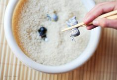 Ninja party game: retrieve tiny toys from a bowl of rice using only chopsticks