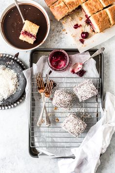 Cherry Filled Lamingtons - Light and airy sponge squares filled with cherry jam and coated in chocolate and coconut. By Emma Duckworth Bakes White Chocolate Blondies, Chocolate Icing, Chocolate Coating, Chocolate Cherry, Cherry Brownies, Coconut Icing, Cake Stall, Square Cake Pans, Pastry Shop