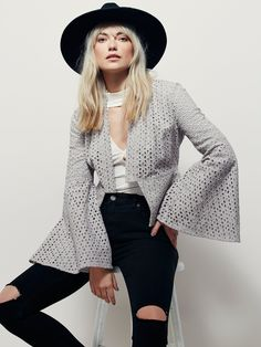 Circle Sleeve Eyelet Jacket | In a structured yet bohemian silhouette, this eyelet jacket features statement flared sleeves with lace-up detailing on the upper arm. Open front with a hidden hook-and-eye closure. Lined.