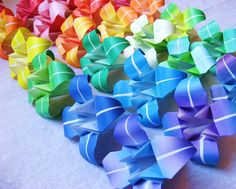 24 Large Origami Irises - paper flowers made to order with rainbow paper - great for gifts, wedding or party favors, and table decorations. $20.40, via Etsy.