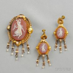 Antique Gold and Hardstone Cameo Suite, comprising a brooch and earpendants each set with a cameo of a dancing bacchante, split pearl accents, and suspending drops, lg. 3, 2 3/8 in.
