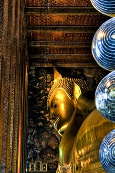 Buddha at Wat Pho, Bangkok  Travel to Bangkok in Thailand to enjoy amazing holidays in Asia. Bangkok City offers the best in shopping, architecture, food and nightlife.  --  Have a look at http://www.travelerguides.net