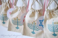 Cute Menorah muslin bags. cute for collecting gelt for the kids.