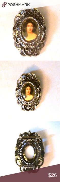 """Vintage Glass Front Cameo Filigree Brooch Pendant Vintage Glass Front Cameo Filigree Brooch Pendant Gorgeous antiqued goldtone metal combination brooch and pendant with painted cameo under glass. Designer: Gerry's Size: 1.75"""" in length Condition: Very good. Tiny bit of patina on edge around cameo. Gerry's Jewelry Brooches"""